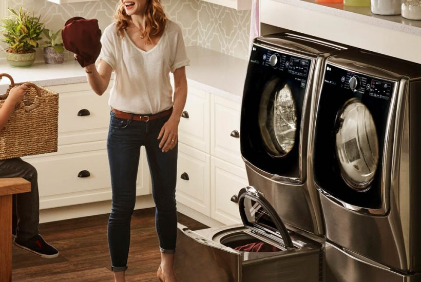 Mom doing laundry with LG Twin Wash System - LG Twin Wash System is Great for Families