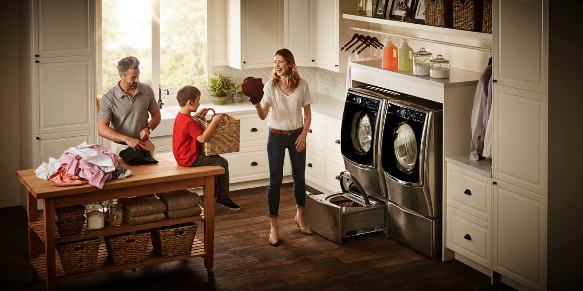 Family doing laundry with LG Twin Wash System - LG Twin Wash System is Great for Families
